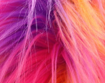 Multi color fake fur. Sold by the yard.