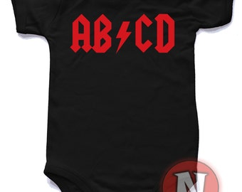 AB/CD baby suit.  Babygrow baby suit in sizes from 0-3 up to 12-18 months and 8 colours. For rock n roll babies only!