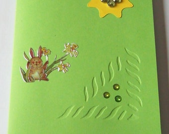 Green card with rabbit and beads