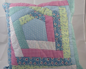 Blue, pink, yellow, green, floral patchwork cushion