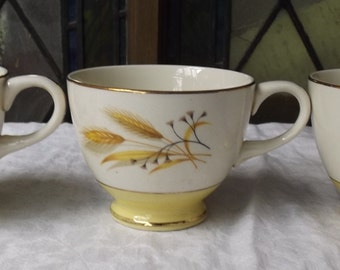 Tea cup with gold wheat motif Century Service Corp Alliance Ohio Autumn gold leaf pattern mid century vintage china