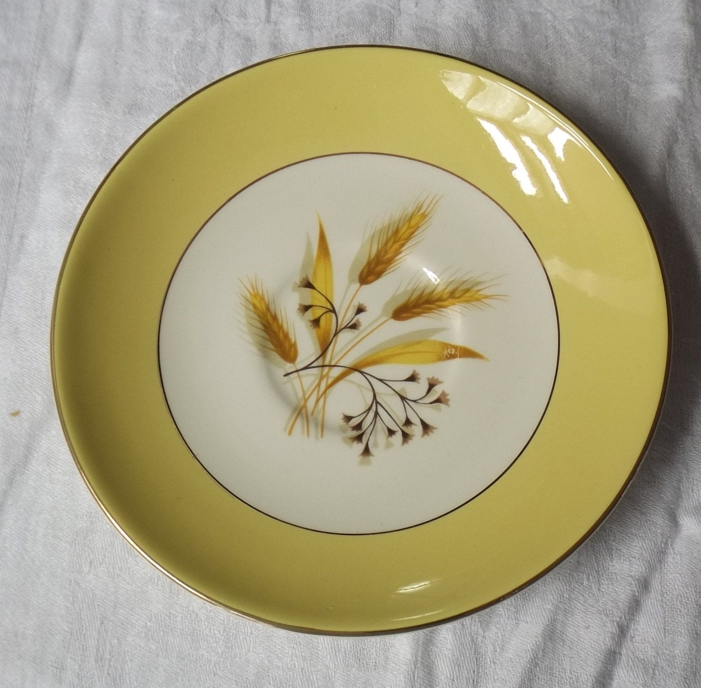 tea cup saucer with a wheat motif Century Service Corporation