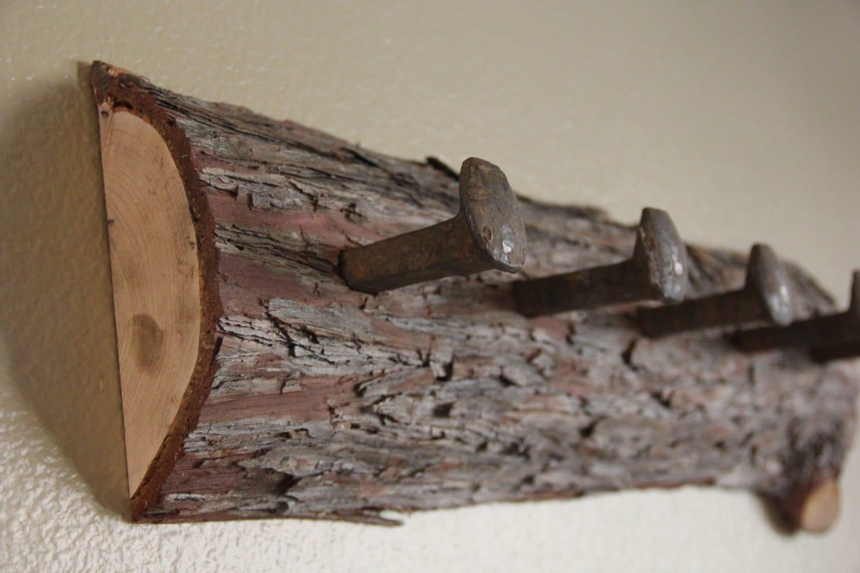 cedar log coat rack with railroad spikes