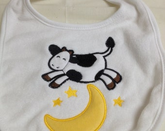 "Baby bib with ""The Cow Jumped Over the Moon"" applique"