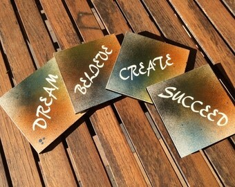 Inspirational coasters with splatter paint design.