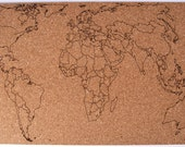 Sheet of Cork engraved with a map of the world