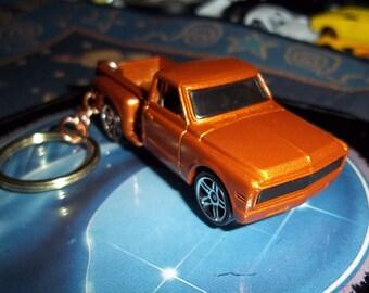 custom made keychain 1969 chevy custom stepside pick up truck,metallic orange W/black mags/repaint-mint