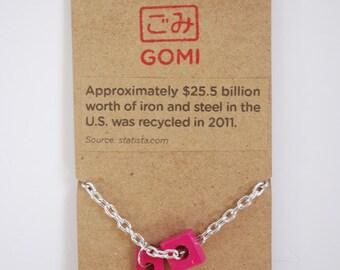 Enamel coated metal jewelry.