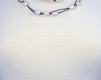 """44"""" Long fresh water pearl necklace weaved on a double strand leather cord"""
