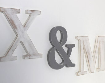 large initials in white and grey wood skated to hang: letters in wood for a wall decoration, a wedding, a birthday,...