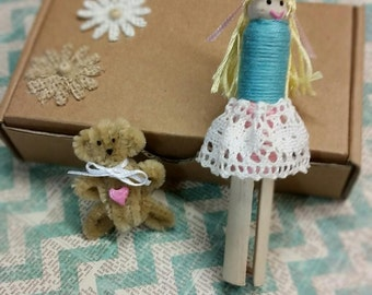 Handmade clothespin doll.  Doll comes in its own box with a teddy bear and special message to your loved one!