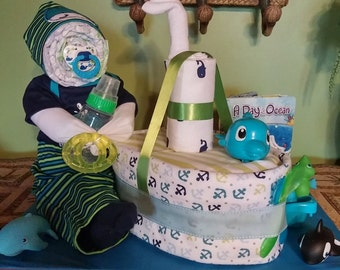 Baby with toy boat diaper cake