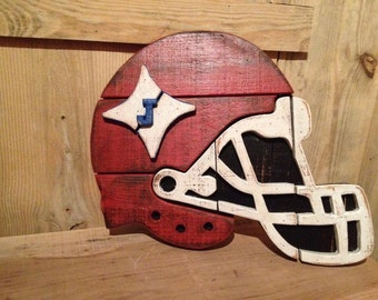 wooden football helmet sign
