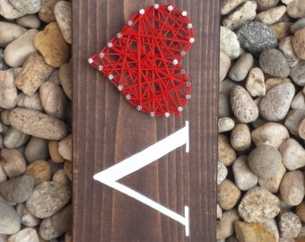 Love with string heart on wood board