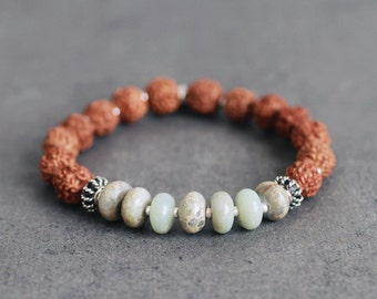 Rudraksha seed bracelet with earthy sea-green Aqua Terra Jasper, sterling silver OM charm