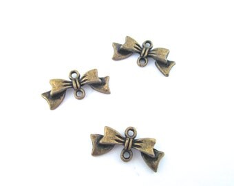 Bow connectors pendant charms, brass plated, pick your amount, G64