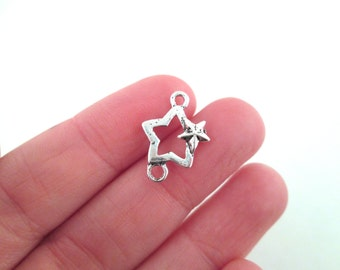 10 silver star connector charms 18x12mm