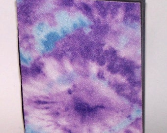 purple and blue tie-dye journal with black pages