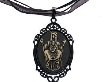 SALE Pendant Necklace Victorian Skeleton Saint Skull Cameo Goth Antiqued Cream on Black Sitting Woman