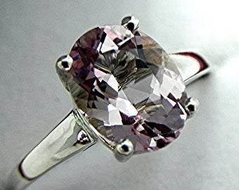 AAAA Natural Untreated Pink Morganite 10x8mm 2.37carats in a 14K White gold ring.