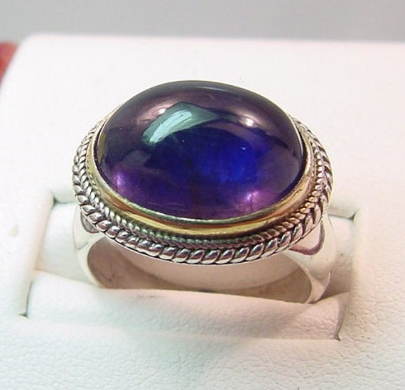 Reserved for Lesly Vivid Blue Iolite 7.13 Carat set in a sterling silver ring with 18K yellow gold bezel 0167