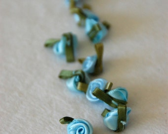 Satin ribbon rosebuds SMALL in baby blue - packs of 10pc