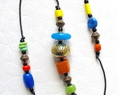 Beaded Garden Chime: Wind Chime with Multicolor Opaque Glass Beads. Turquoise. Lime Green. Orange. Yellow. Blue. Fiesta Colors. Brass Bell