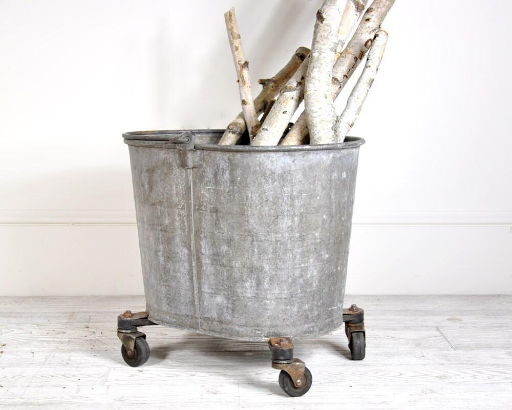 Vintage galvanized metal bucket on casters industrial for Metal bucket planter