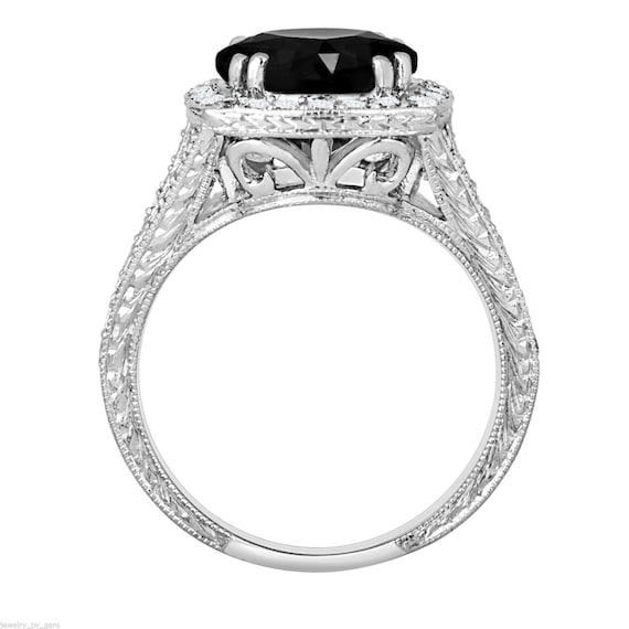 Platinum Fancy Black Diamonds Engagement Ring by JewelryByGaro
