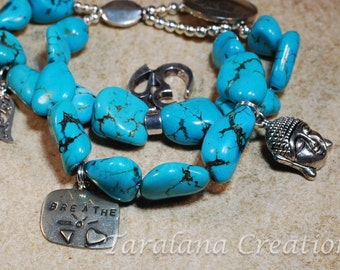 Double Stranded Chunky Turquoise Bracelet with Silver Charms and a Button Clasp
