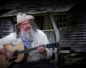 Old Time Folk Singer with Guitar by a Wooden Cabin in Appalachia No.0781 - A Fine Art Rural Music Landscape Photograph