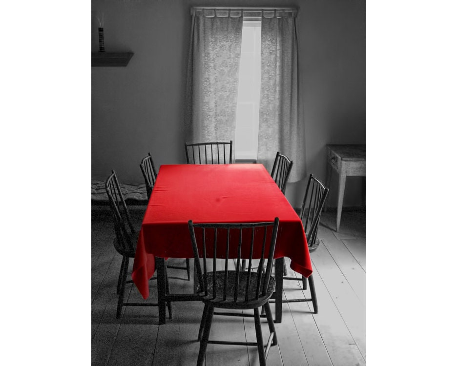 red table cloth and dining room in a black and white setting a