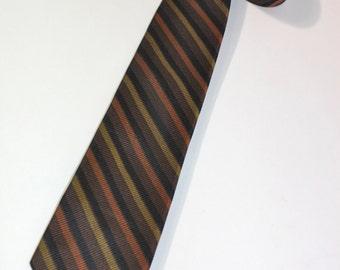 vintage 50's - 60's -Regal- skinny neck tie. Repp stripe in Brown Gold Black & Russet. All Silk