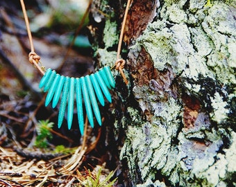 Turquoise tribal howlite spear on adjustable leather cord can be substituted for hemp or chain