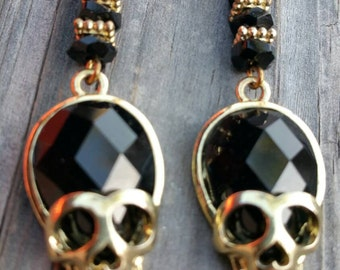 Edgy gold and black faceted crystal skull earrings