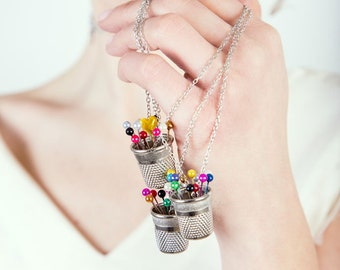 Long necklace with pendant thimble and bright colors pins, mod. Brilla