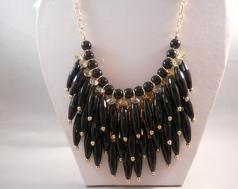 4 row Bib Necklace with Black, Gold Tone and Clear Crystal Dangle  Pendants