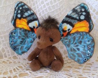 To order Artist teddy bear – Elephant - butterfly Flower