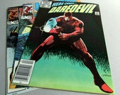 Set of 3 Vintage Daredevil Comic Books, No. 193 April 1983, No. 215 February 1985, and No. 220 July 1985, Marvel Comics