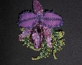 Diane's Cattleya Orchid. A fantasy bead embroidered and beadwoven brooch