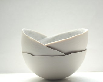 Porcelain bowl. Stoneware Parian porcelain bowl in mushroom color with mat interior and crystals.