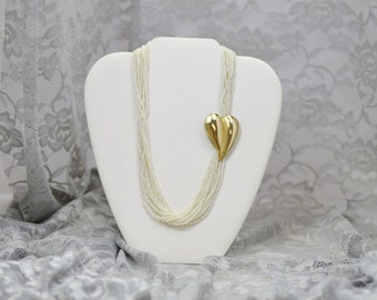 White Micro Bead Necklace With Gold Heart Clasp Detail