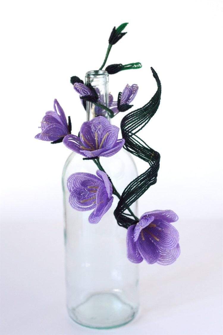 Purple gladiolus vine wine bottle decoration by