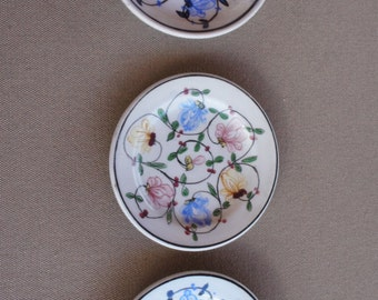 "Porcelain saucers/ plates hand made in Portugal.  3 vintage 3.5"" plates.  - floral motif- excellent condition - china"