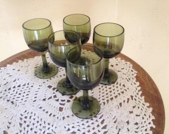 Wonderful vintage set of (5 ) Green Glass Pedestal Cordial or Shot Glasses
