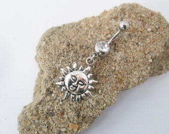 Sun bellybutton ring piercing