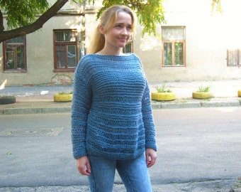 Knitted women's blue sweater. Loose knit sweater.