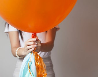 36 inch Orange Balloon with Orange, Celery, Mint, Light Blue and Gold Colored Tassel Garland