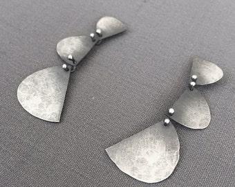Three Half-Moon silver earrings, hammered finish