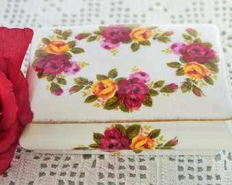 A very sweet bone china lidded 'Cottage Rose' trinket dish.This would make a lovely gift.